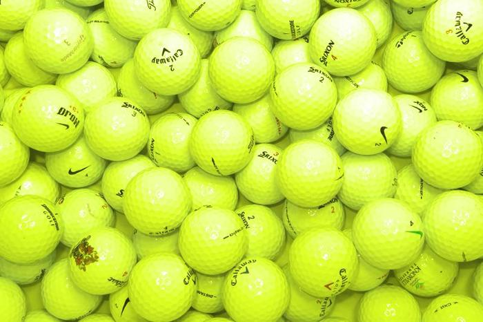 24 used very good condition golf balls (lots of yellow )