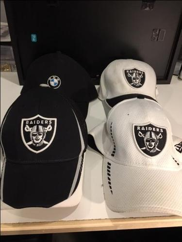 3 different Raiders Ball caps and BMW ball cap 15 dollars each,