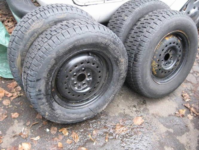 4 Snow tires 205 70/14 on 5x100mm rims for Dodge Caravan ...