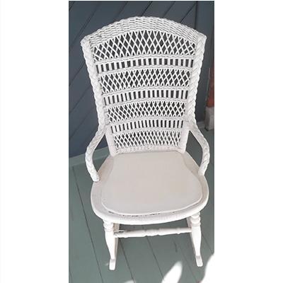 Antique white rattan rocking chair