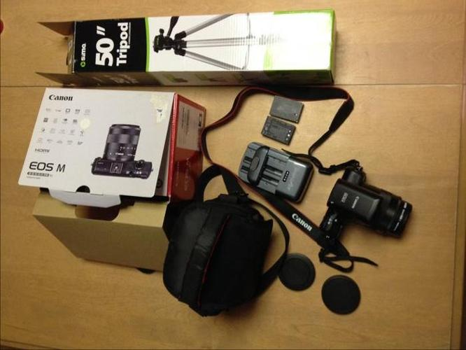 Canon EOS M camera with flash, case, tripod, extra battery