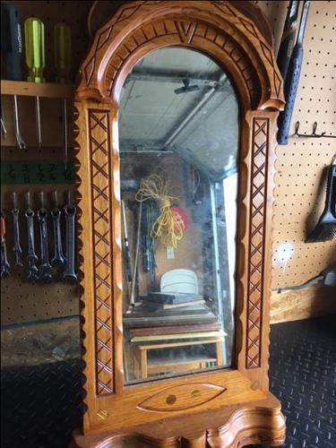 hand crafted wooden mirror, solid upright oval detailed