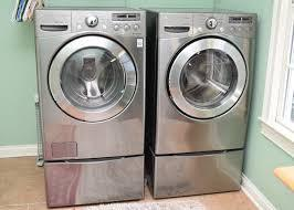 LG Front Loader Washer and Dryer with base