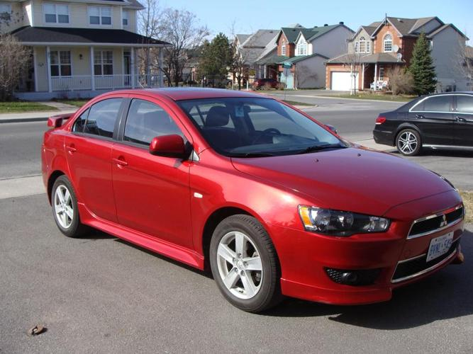 Mitsubishi Lancer 10th year anniv., lowest price, lots of extras