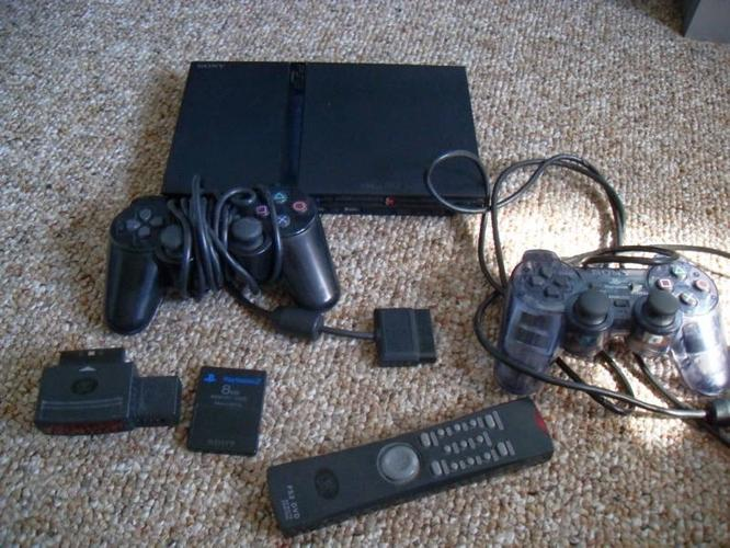 PS2 Slim and Games. 75$ Firm.