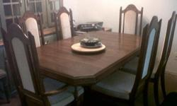 Oak dining room table and 6 chairs (need new upholstery) with insert. Also oak buffet and hutch (glass is missing in left door of hutch). $100 each OBO