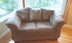 """Used grey microfibre love seat for sale. In great condition. Selling because we just got a couch set. Measurements are approximately: 63"""" width 38"""" depth 34"""" height (with 4"""" removable feet on) Website link is for current version of this love seat for sale"""