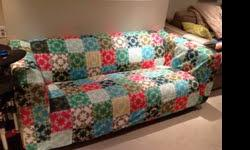 We are selling our KLIPPAN loveseat from Ikea. It is in very good used condition, no stains, as we've always used a slipcover on it. The current slip cover is included with the couch, but can easily be removed. The couch is white underneath.
