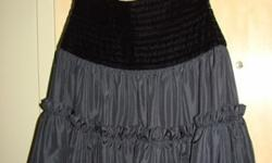 Wayne Clark vintage evening skirt. Taffeta with black velvet waist detail. Size 6. In mint condition. From Wayne Clark line in late 70's.