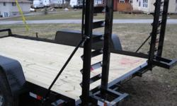 "New 2012, 10,000 lb black powder coated Gator trailer with 4 wheel brakes on 5200 lb axles  15"" wheels on silver wheels. ajustable loading ramps Call 5FishResort  705 857 1754"