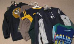 10 boys clothing pieces size 6-7 items for one price. (3 brand new items with tags) see below for list of items: 1 starter jacket with tags 2 sweatshirts 1 CCM football shirt 1 pair pj's still with tags 1 gap hoodie (like new) 1 pair pj bottoms with tags