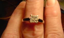Gorgeous 10K white gold diamond ring which has 4 nice size princess cut diamonds in an invisible setting and looks like one large diamond solitaire ring, size 6 and can be resized, recently cleaned, asking only $400.