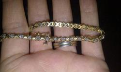 This bracelet has been to two jewelery stores so I can know an estimate of its worth.  It has 30 individual cut diamonds and is not gold plated.  It is 10 Karot (? spelling) gold and is and old bracelet.  If it doesn't sell in the next few weeks it will