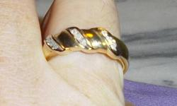 THIS IS A LARGE, SIZE10+, STAMPED 10K GOLD RING, THICK,  WITH 9 DIAMONDS. LIKE NEW, GREAT DESIGN, REALLY SHINES. THE 9 DIAMONDS ARE LARGE ENOUGH TO BE SEEN THROUGH THE BOTTOM OF THE RING.