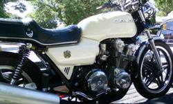 selling this cb750 - 10th Anniversary Edition bike. It is in amazing condition! Originally brown, and painted pearl white. Has 4 into 1 exhaust. Straight-bars. Safety & E-tested in 2010 (and would pass both with flying colours now). Original owners manual