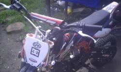 Great Starter Bike, comes with...Tank of gas, Jug of Oil, Fuel&New Fuel Can, Cert of Origin & Owners manual. 4 stroke 110cc I rode the bike 3 times for an hour total, this bike is still like new. Includes Tank of gas& Oil For its first oil change when