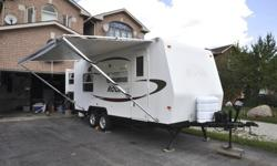 21ft travel trailer, like new, very clean, rear queen bed hard slide out, bunk beds up front, fold down couch, fold down table, sleeps 8, ducted A/C and heat, stove, oven, microwave, CD stereo, heated mattress, so much more!