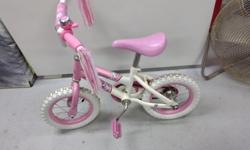 "12"" princess pink bike ,has no training wheels .$20.00 250-748-8729"