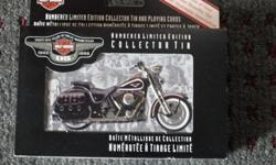 Harley-Davidson numbered limited edition collector tin with playing cards.This is the Canadian edition for the 95th anniversary of great motorcycles.Card decks are still sealed, with the cardboard sleeve, tin is unscratched and all in mint condition item