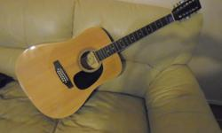 MADERA, (slight dip at the sound hole)like all used 12 strings, if u can see this ad,YES,its available,,,,click on VIEW SELLERS LIST TO SEE MORE GREAT STUFF