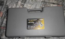 """NEW! Never been used!! 12 Volt Electric Car Jack by """"Sunforce"""". This scissor jack is for a car whose total weight is 1 ton or less. 12 foot cord plugs into cigarette lighter, Voltage is DC 13.5 V. Weight of electric jack is 4.10 kgs. Operation"""