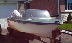"""13' fiberglass Crestliner Mustang runabout with 40 hp Evinrude outboard in good condition ( 16' roller boat trailer with 8"""" tires and good lights $500. extra. not trailer in picture. )"""