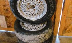i have a set of spoke mags with tires 175/70R13 $150 Phone Cell 250-462-6797