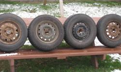 "4  Winter tires on 4 bolt rims""   2x  Bridgestone Blizzak 155/80-13 2x  Goodyear Nordic 175/70-13   Tires are in good shape with lots of tread depth.   $200   Phone: 345-1020"