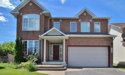 # Bath 3 MLS 1017598 # Bed 4 Gorgeous detached brick home on huge pie shaped lot! Hardwood throughout w/stunning accents make this home feel like a castle! Huge eat-in kitchen features granite counters, loads of cupboard space & large ceramic tile