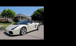 CALIBER AUTO LTD. IS VERY EXCITED TO OFFER FOR SALE THIS GORGEOUS LAMBORGHINI GALLARDO PRESENTED IN A PEARL WHITE WITH A BLACK INTERIOR, THIS CAR IS STUNNING! NO PREVIOUS DAMAGE OR ACCIDENT HISTORY BOTH CARFAX AND CARPROOF VERIFIED, THIS CAR IS EQUIPPED