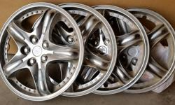 """Set of 4 plastic wheel covers to fit 14"""" rims.5 spoke, 5 nut design. Tension ring snap on mounting. Excellant condition."""