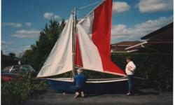 A Stevenson (California) design based on Chesapeake Bay Oyster boats this light (under 150 lbs.) hand-built sailboat was modified in the planning to have Mainsail and Jib rigging. Full length keel, easy to beach and transport on trailer (included). Sails