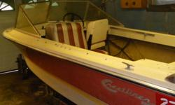 """14.5' fiberglass Crestliner runabout with brown top and fishfinder with 50 hp Evinrude outboard in good condition ( 16' boat trailer with 13"""" tires and spare, tounge Jack, $600. extra"""