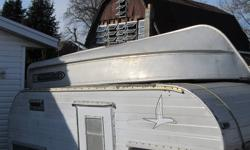 older 14ft McCulloch aluminum boat, in great shape, comes with 2 ors. $500 obo. please call 519-752-5415