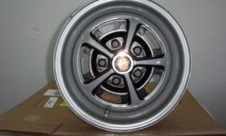 """14""""x6"""" Magnum 500 Wheels fit GM cars,blasted & painted with caps $400.00 set of 4 Brantford 519-484-2280"""