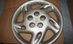 """Set of 4- 14"""" Pontiac hub caps. Excellent shape. Used only 1 season.  Sold car. Bought from GM dealer in Truro for $80 each."""