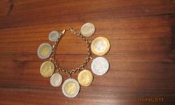 14K Gold Italian Rolo Bracelet with 9 Italian coins. Beautiful bracelet in excellent condition. $225.