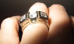 NEW LOWER PRICE.  Priced to sell.  Beautiful custom designed 14K white gold ring with 3 diamonds--2 princess cut on either side of 1 round brilliant cut diamond.  Approx. 1.15 total carat weight.  Diamonds are nice and sparkly with approx. I color, SI3