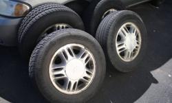 4 Aluminum 15' Rims (originals from a 2004 Chev Venture Van).  Plus 4 tires P215/70R15's (3 all-season and 1 winter.. in decent shape).  $100 obo.  724-2722.