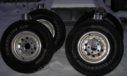 Wheels and tires in good condition. 5 bolt were on a Ford F-150 and Ranger. Will not fit my truck because it was lowered by the previous owner.   located in barrie   31X10.50 R15 LT Daytona A / T