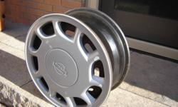 "4 15"" Nissan factory steel wheels with Nissan Hubcaps  Great for winter tires"
