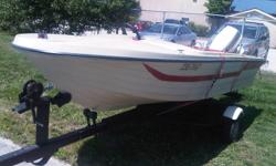 15' Sport Ray with 50 HP Johnson fully rebuilt motor. - new battery 2011 - new tires on the trailer- 2011 - new wiring and light - starts and runs great. - electric start - Excellent for water skiing or tobboganing. - pulls easy with a 4 cylinder car (no