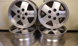 "Set of 4 15x7 tire size, 5x4-1/2"" bolt pattern aluminium rims off of a Chevrolet Jimmy/Blazer. Asking $200 for the set, in awesome condition."