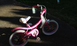 Girls cream soda. Purchased 1.5years ago but has only been ridden a couple of times. Still has the rubber fingers on the tires. Excellent used condition