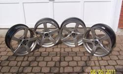 4 rims off a of 2008 saab. very good condition