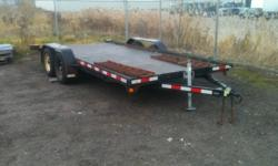 Flatdeck trailer, 2 3500lb dexter axles with brakes, brakes and bearings were done in fall of 2010, trailer has less than 6000km on it since. Deck boards in good shape, pic shows rubber mats on top, but they will be removed. Has ramps that slide in the