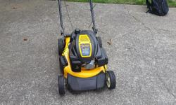 This 6.75ohv engine has plenty of power for long grass.Rear wheel premium drive for easy cutting up a hill or level surface.One pull easy start with a 3 in 1 bag., mulching side discharge.This mower is clean and works well,new oil with a new blade.,rear
