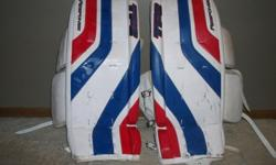 Excellent condition. Used for 2 seasons. Still look practically new except for some minor puck marks that I wasn't able to remove. One of the pads is missing the toe cover, but does not affect the function of the pad. (shown in picture)Size: Intermediate