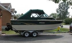 1996 Offshore Fisherman 23 1/2 foot boat with 350 5.7L V8 chevy engine and Alpha One outdrive. Boat comes with 9.9 mercury kicker motor, oars, VHF radio, fish finder and other extras. Call Lynn or Greg for more details.