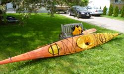 17 foot sea kayak with rudder padded seat and backrest. comes with spray skirt, carbon paddle and life jacket. $1700.00 obo